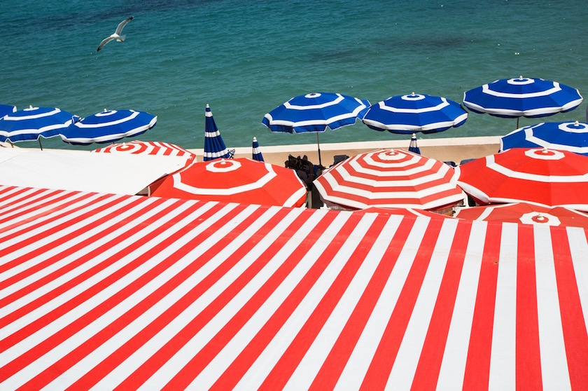 holidays holiday vacation vacations parasol parasols red blue stripes bird water sea beach