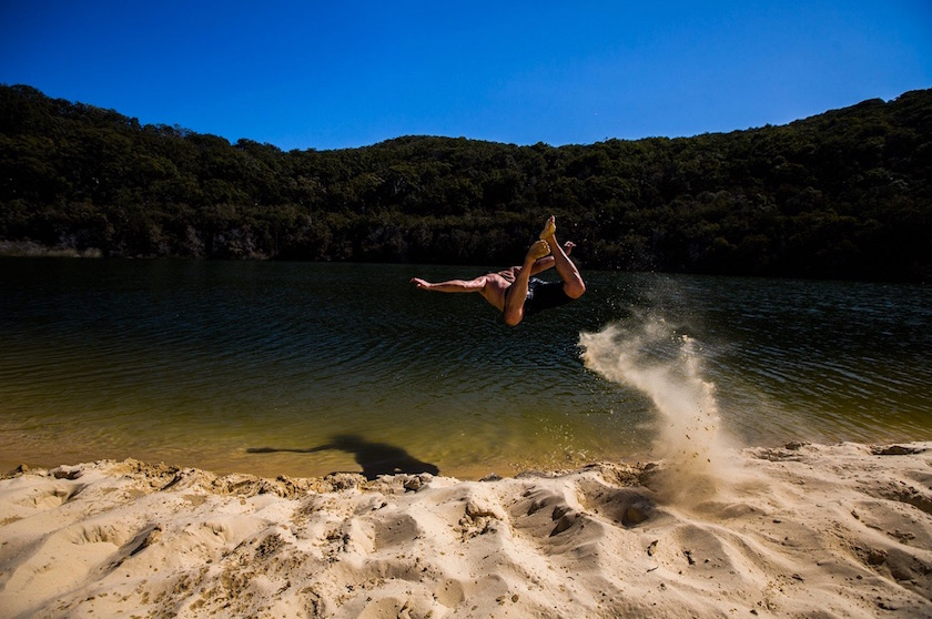 man jump beach lake water swim summer sun sunny