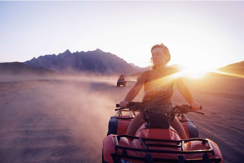 woman quad desert sunset sundown light drive driving