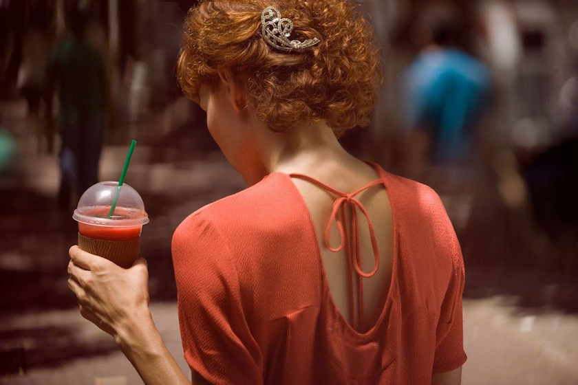bright ginger woman outside drink drinking juice smoothy green straw salmon waling drink drinking summer warm bright thirst thirsty knot bow