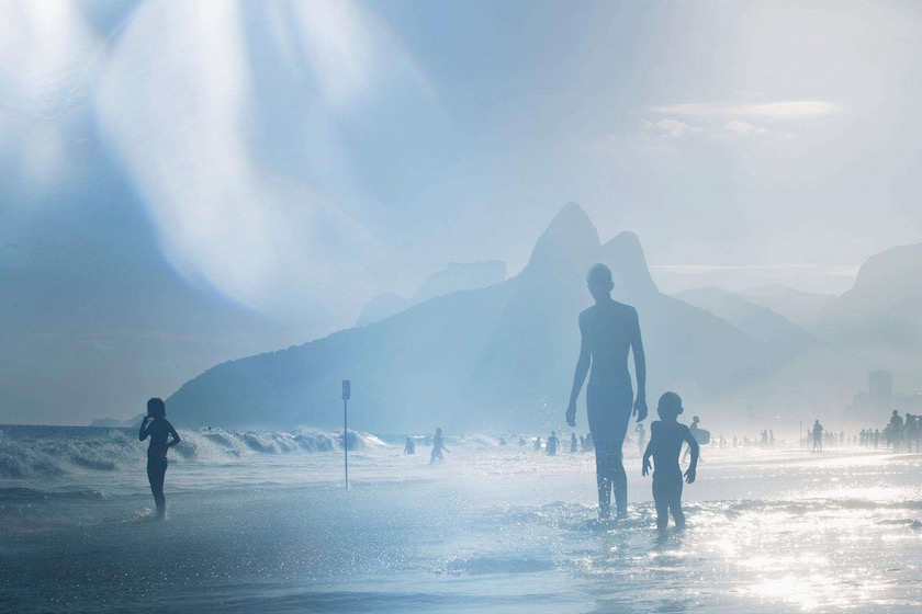 man kid boy young kid beach play sun sunny warm summer holidays vacations wave waves sea ocean brazil silhouette blue