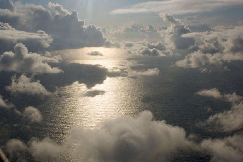 cloud clouds water ocean sea fly flying above
