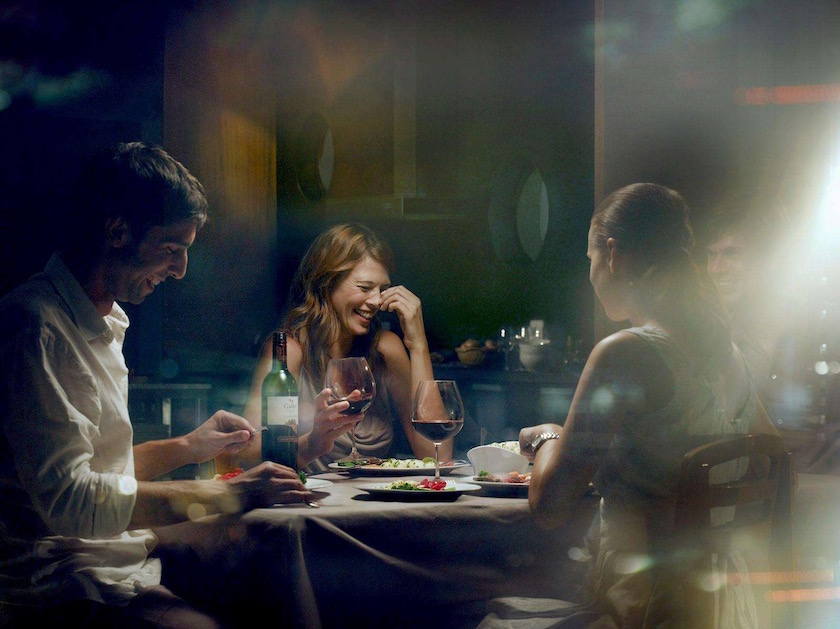 friends man woman sit sitting eat eating dinner wine food drink drinking fun joy happy happiness couples laugh laughing