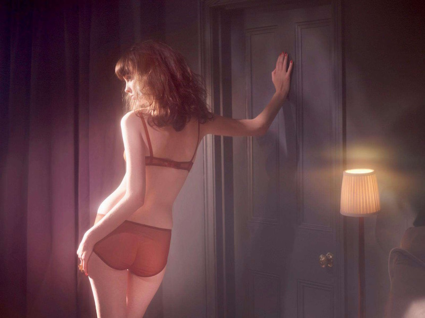 woman lingerie underwear room dark lamp back backside lean door