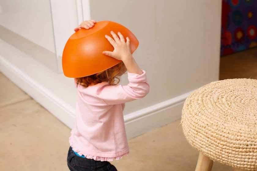 girl curly kid kids child children rose orange bowl covered hide hidden chair stool walk walking