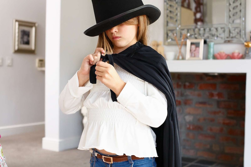 girl kid kids child children play dress outfit costume zorro black hat cape hide hidden