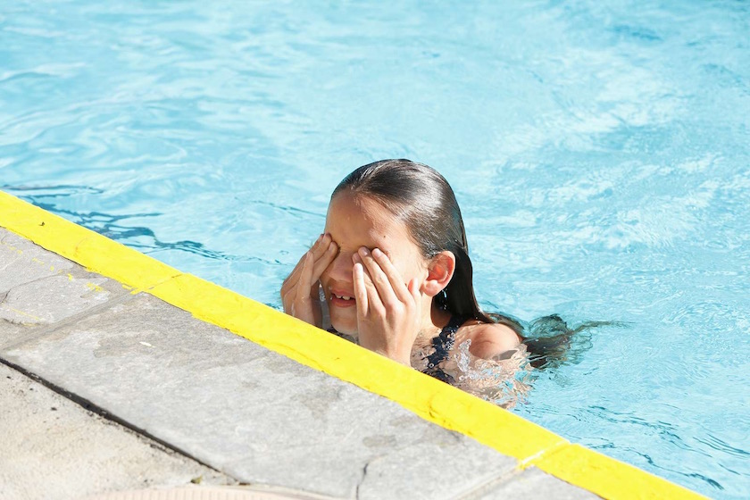 yellow line girl kid child children kids water pool swim swimming hide hidden wet sun sunny warm outside sport sports