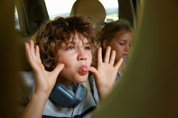 boy kid child children headphones earphones car joy funny fun happy funny joke tongue grimace snoot sister brother