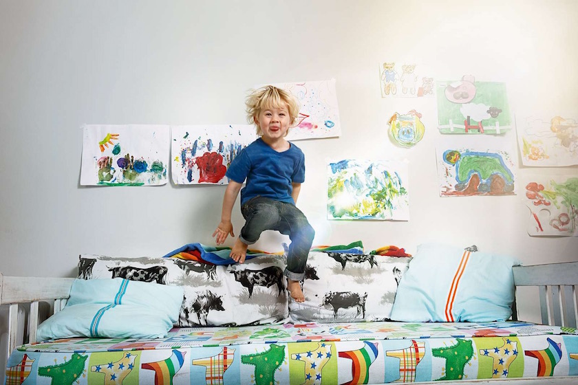 boy kid laugh smile joy happy laughing smiling rainbow horse horses bed jump play paintings wall sunflare