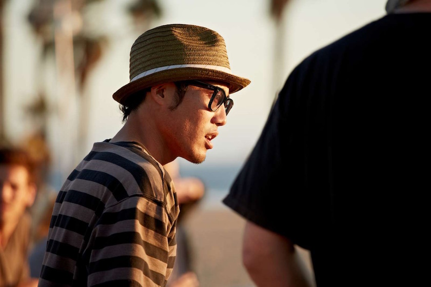 man glasses asian hat stripes beach sun sunny face profile
