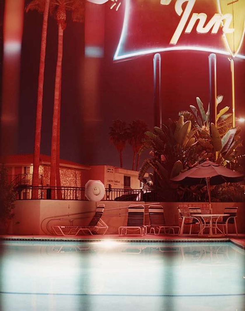 pool dark night evening motel palms trees empty