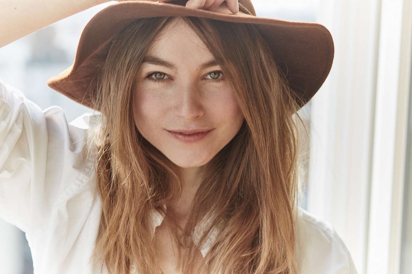 woman face head long hair blond laugh smile happy smiling laughing hat brown