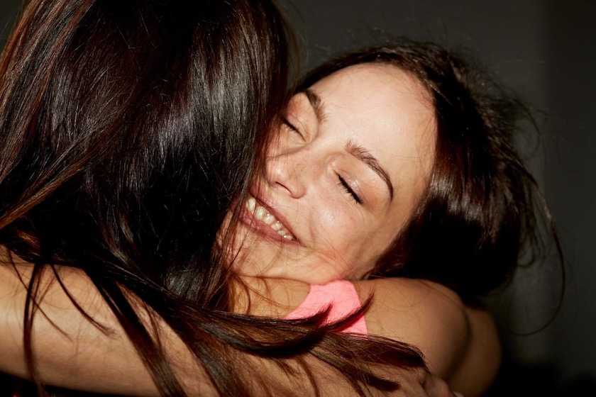 women woman face closed eyes friend friends happy laugh laughing smile smiling hug touch bodycontact