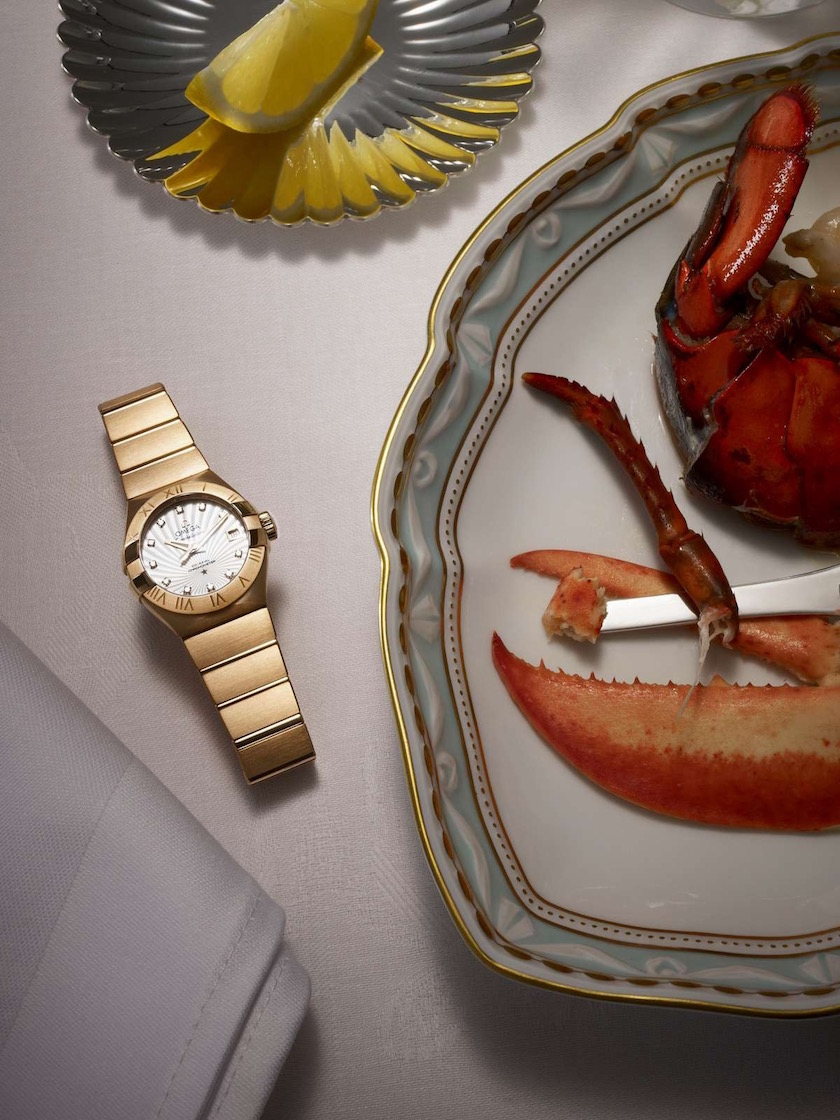 gold golden table food watch lobster lime