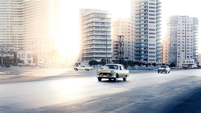 cityscape city buildings sun sunny bright light car vintage cars