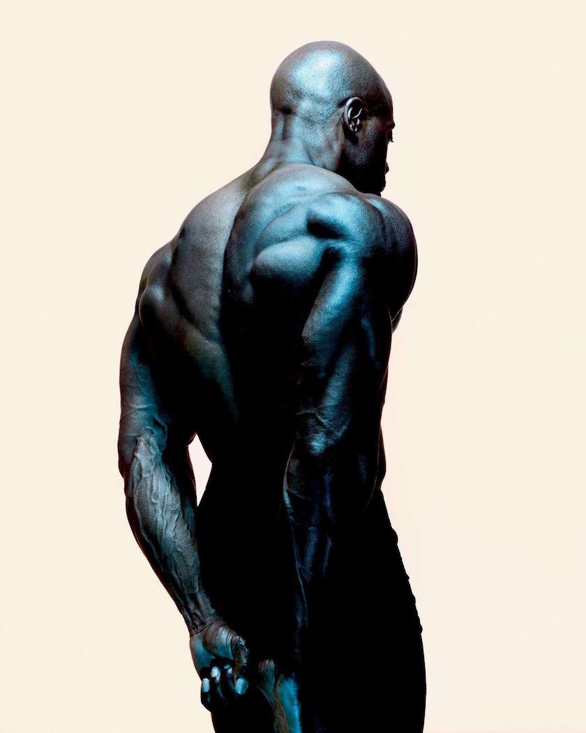 photograph photographer photo photographers photography man black muscled muscles strong power bodybuilder light green pose flex flexing