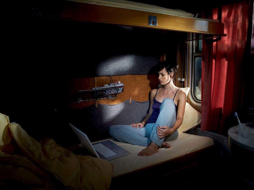 photograph photographer photo photographers photography woman travel train night nights evening laptop bed pyjamas toothbrush red curtain