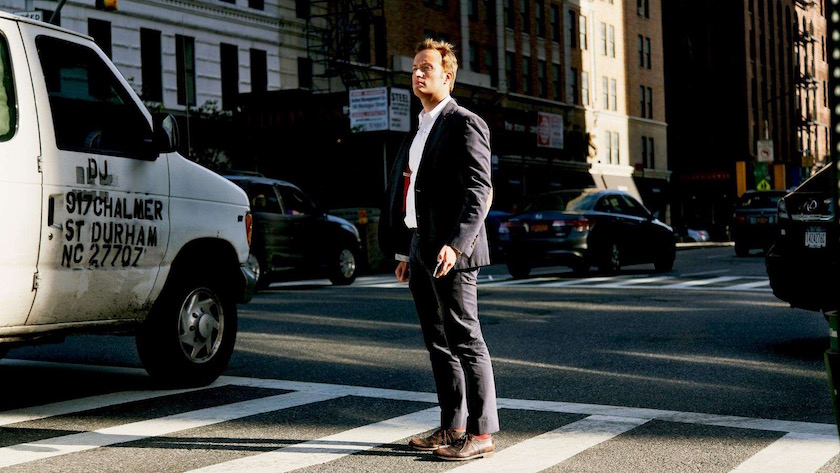 photograph photographer photo photographers photography man urban city sunny sun street crosswalk stripes car cars stand standing