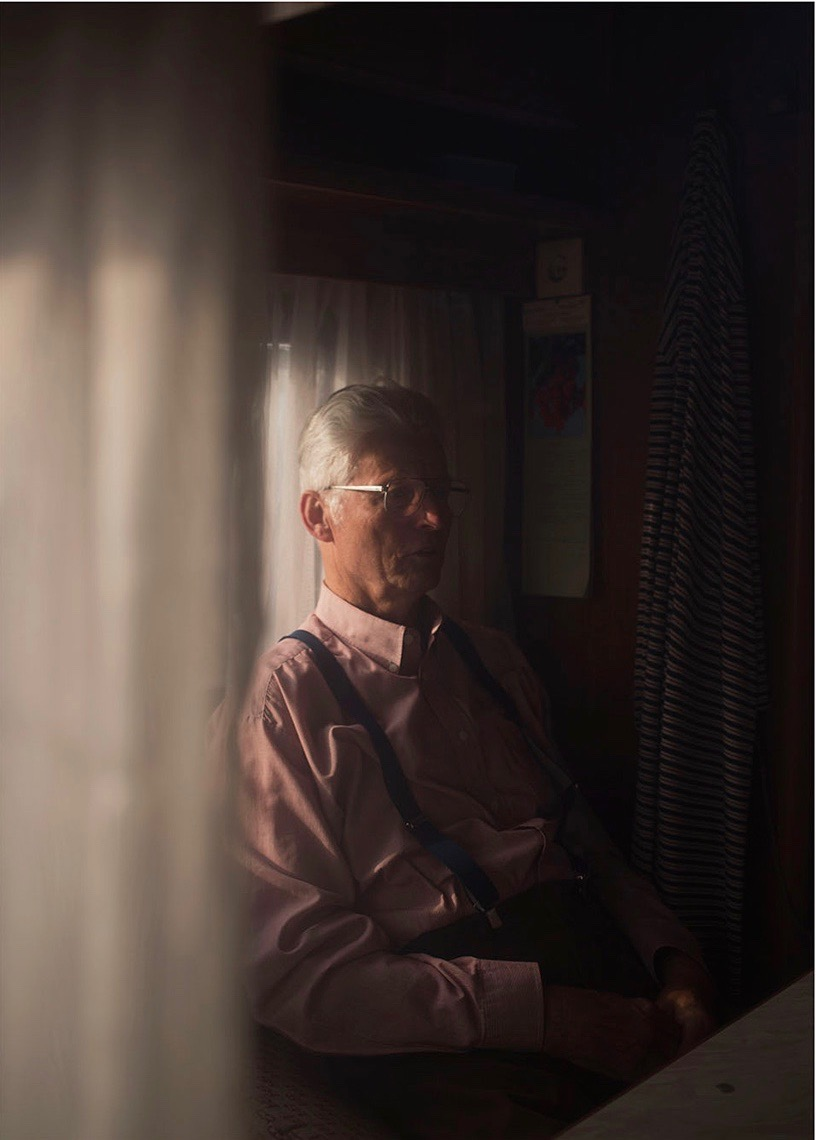 photo, photos, photography, photographer, photographers, man, men, elderly, suspenders, curtain, curtains, indirect, off camera, stare, sad, negative