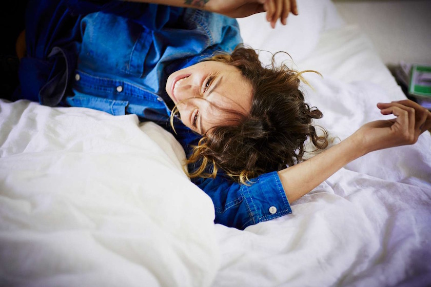 photo photos photography photographer photographers young woman bed lie lying denim laugh laughing smile smiling