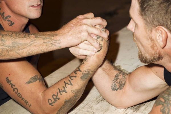 "photo photos photographer photographers photography man men strong power powerful compete competition tattoo tattoos tattooed face bald balding head ""arm wrestling"" ""arm-wrestling"" hand hands arm arms muscle muscled muscles"