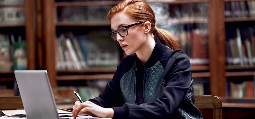 photo photos photography photographer photographers young woman ginger face head glasses work working study library books blurry laptop desktop
