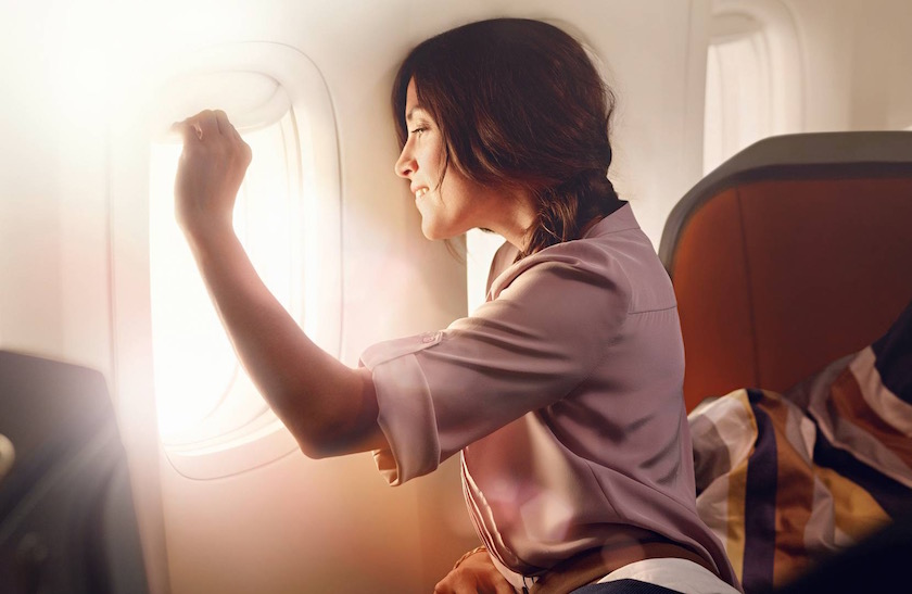 photo photos photography photographer photographers woman plane fly flying sun sunny blurry sunflare