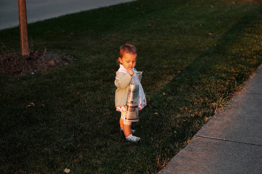 photo photos photography photographer photographers child children baby babies girl little young stand standing newspaper sun lawn