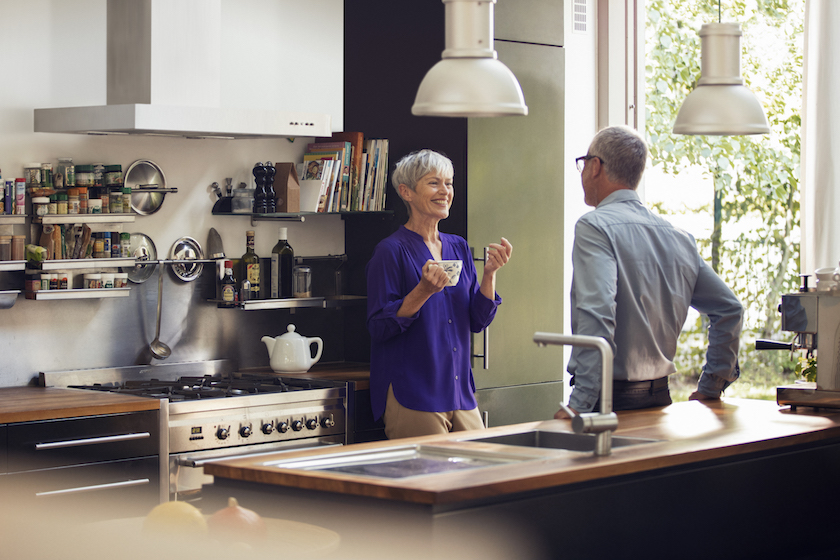 photo photos photography photographer photographers woman old mature man sun sunny home kitchen talk talking drink drinking tea coffee garden blurry happy smile smiling