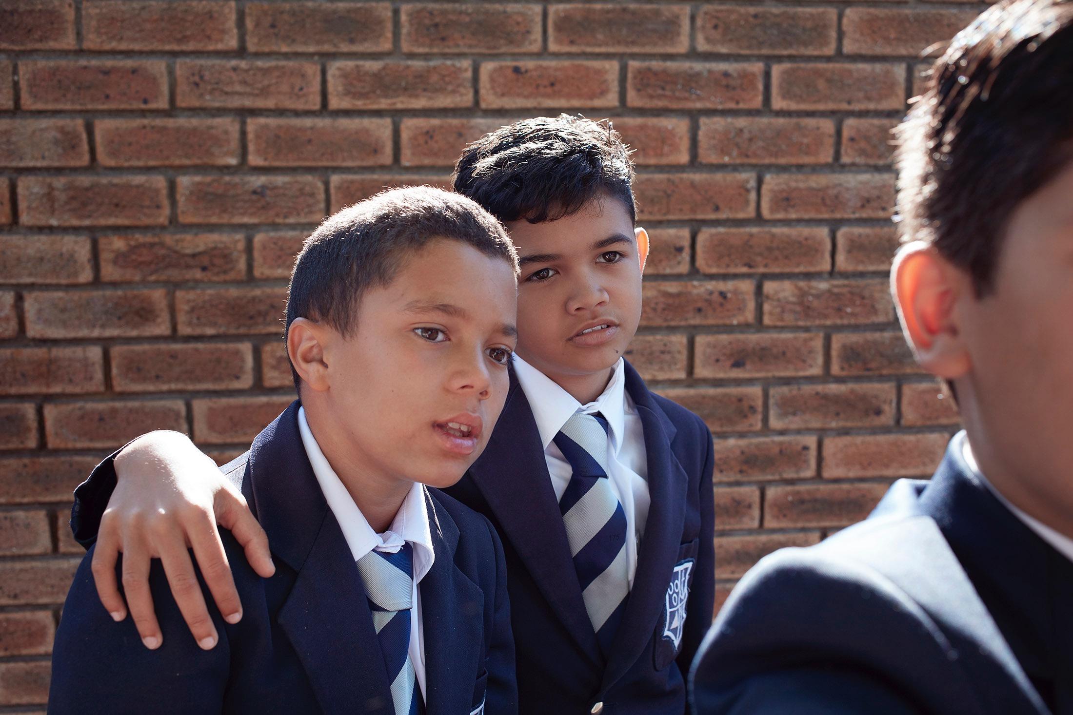 photo photography photographer school uniform education boy boys friends wall bricks