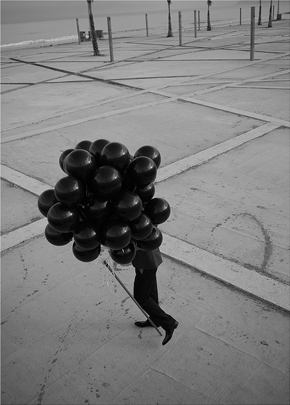 photo, photos, photography, photographer, photographers, black and white, blackandwhite, bw, b&w, dark, man, men, parking lot, grid, balloon, balloons