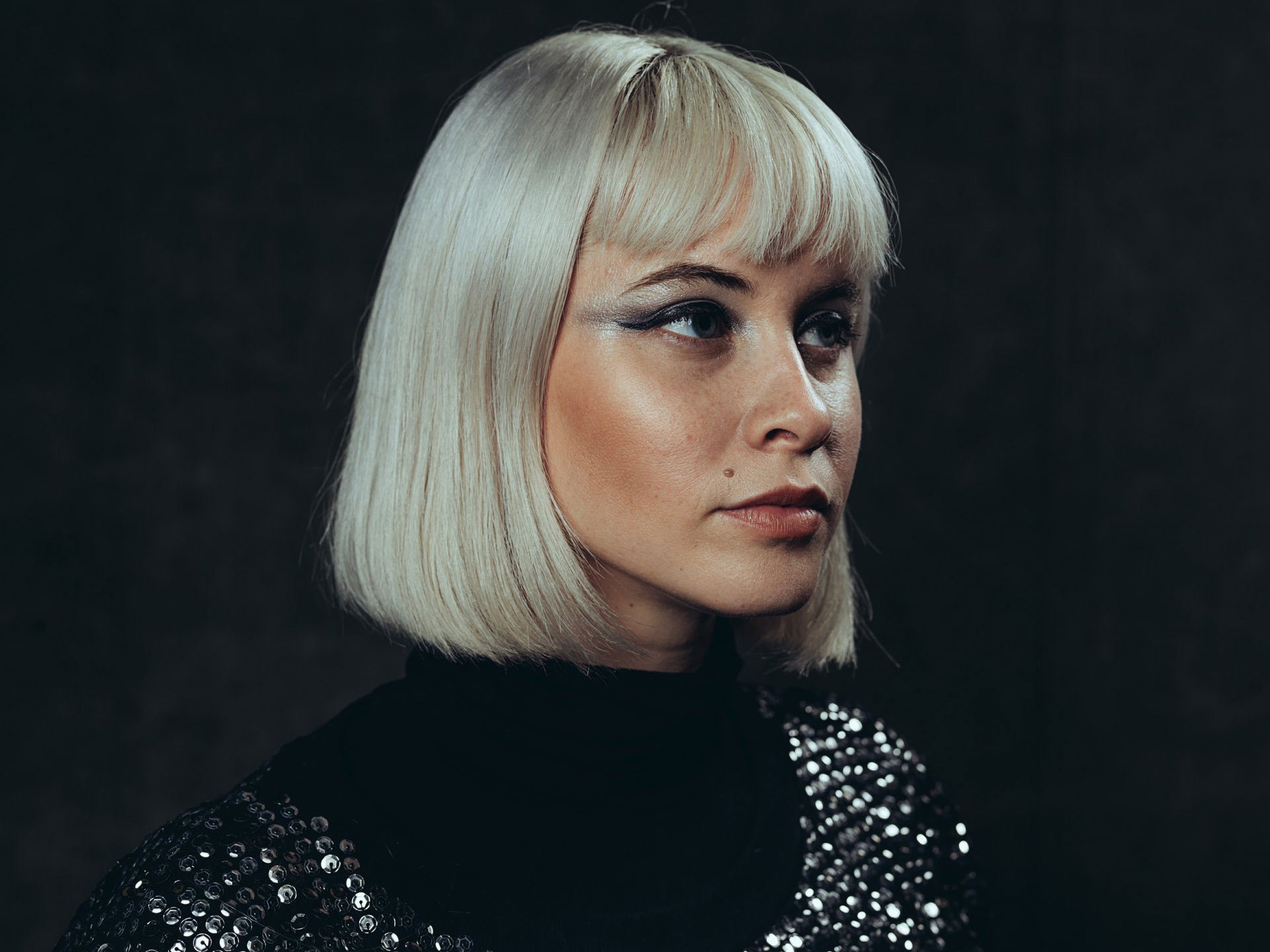 ­photo, photos, photography, photographer, photographers, woman, women, blonde, wig, platinum, bangs, eyeshadow, makeup, editorial, beauty mark, sequins, silver, dark, studio