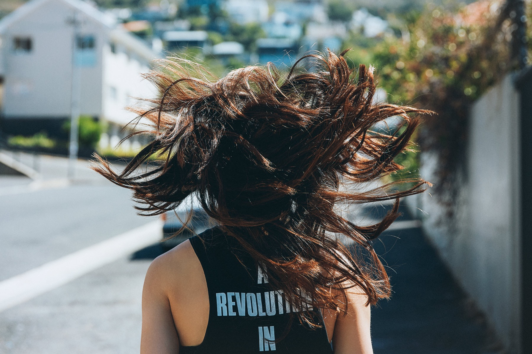 ­photo, photos, photography, photographer, photographers, woman, women, nike, candid, sunny, sunlight, hair, walking, street, streets, blur, blurred background, a revolution in, residential, suburban
