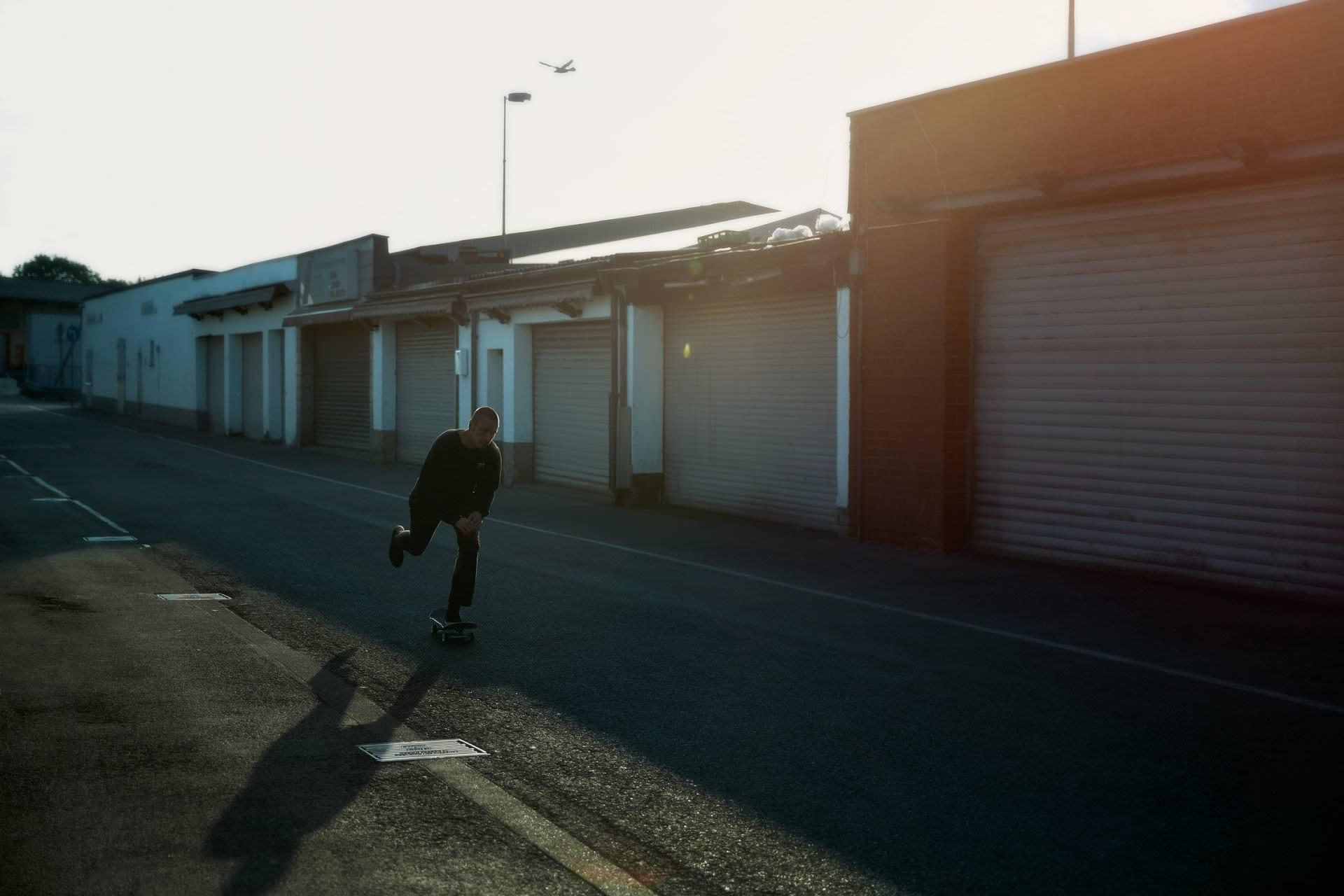 photo, photos, photography, photographer, photographers, man, men, skate, skating, skateboard, dark, shadow, building, buildings, lot, street