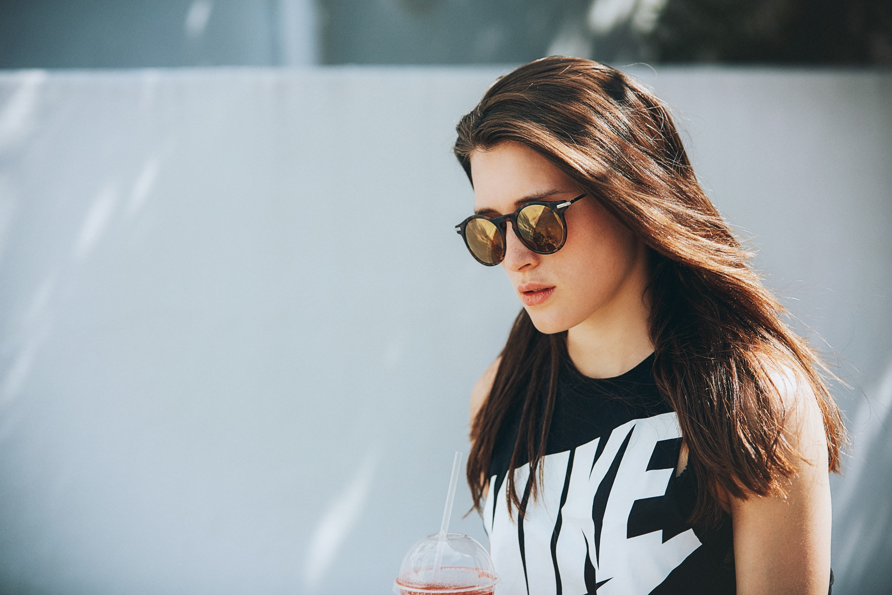 ­photo, photos, photography, photographer, photographers, woman, women, blur, blurred background, drink, sunglasses, nike, candid, sunny, sunlight