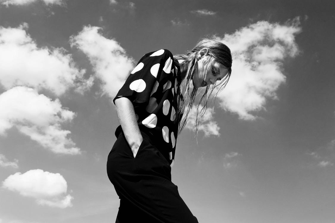 photo, photos, photography, photographer, photographers, woman, women, black and white, blackandwhite, bw, polka dots, spots, pattern, blouse, sky, clouds, sunlight, sunny, dress, blonde, walk, walking, editorial
