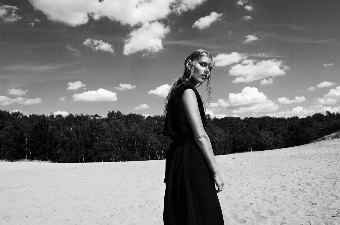 photo, photos, photography, photographer, photographers, woman, women, black and white, blackandwhite, bw, sand, sandy, beach, beaches, tree, trees, sky, clouds, sunlight, sunny, dress, blonde, walk, walking, editorial, over the shoulder
