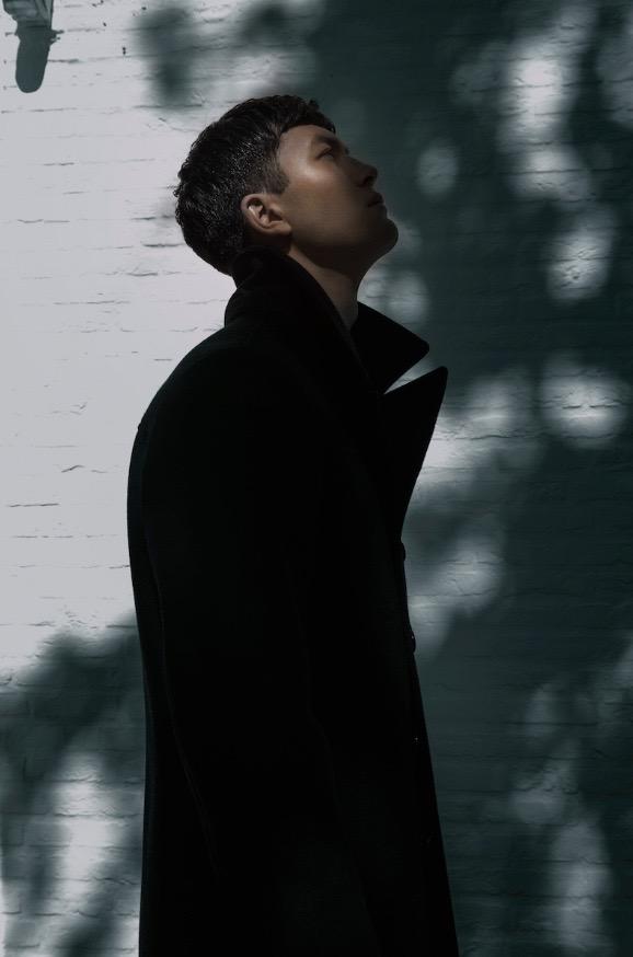 photo, photos, photography, photographer, photographers, man, men, pose, posing, stand, standing, brick, brick wall, shadow, shadows, highlight, editorial, coat, coats, profile, side view