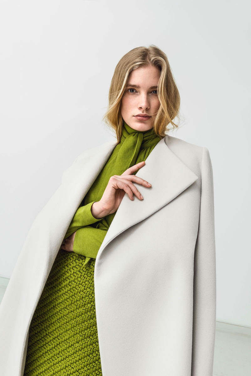 photo, photos, photography, photographer, photographers, woman, women, pose, posing, green, sweater, stare, blonde, white background, white walls, editorial, coat, coats