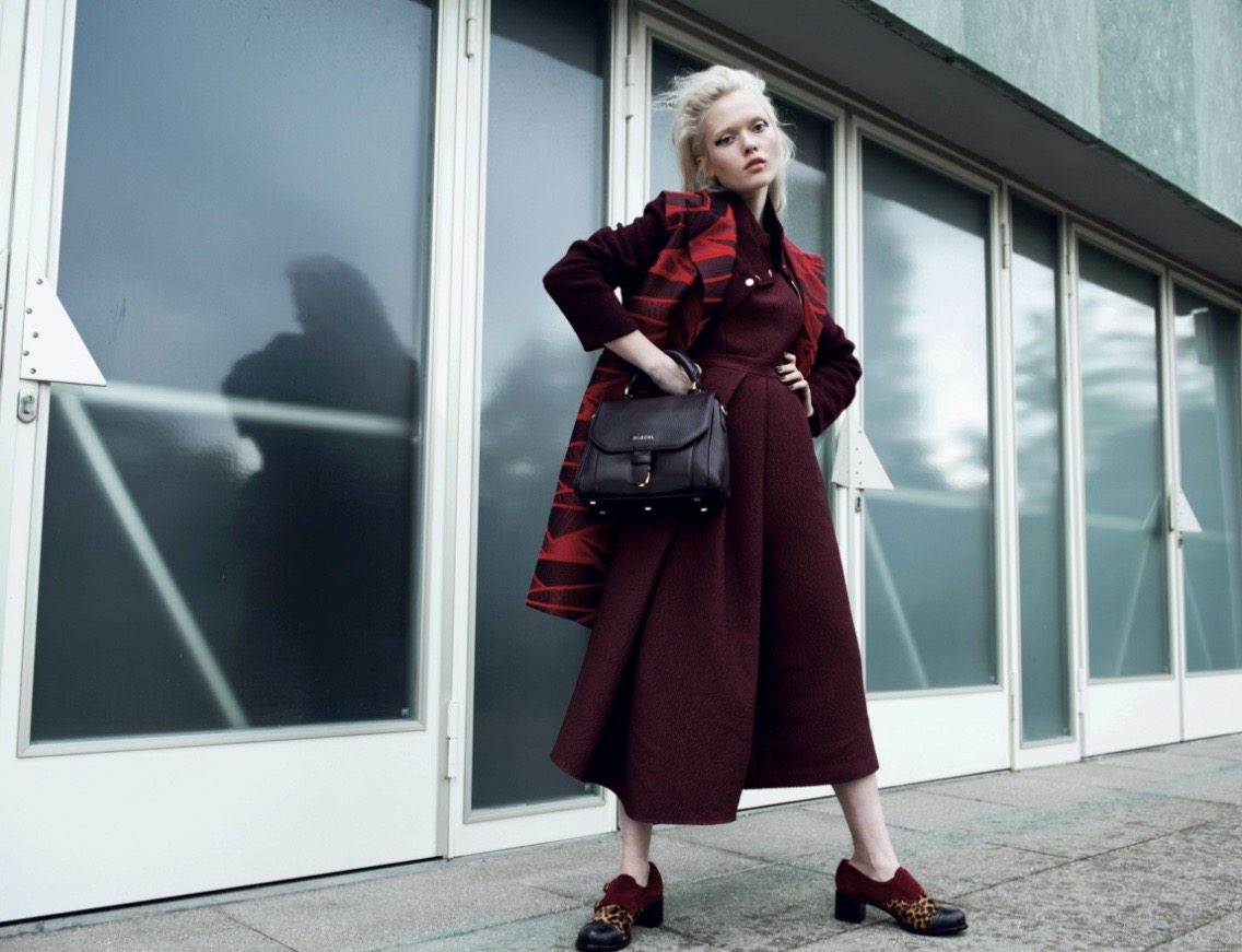 photo, photos, photography, photographer, photographers, woman, women, stand, standing, pose, posing, editorial, leather, leather bag, purse, purses, blonde, window, windows, reflection, reflections, overcast, cloudy, cool light, cool lighting, red, maroon, shoes, shoe