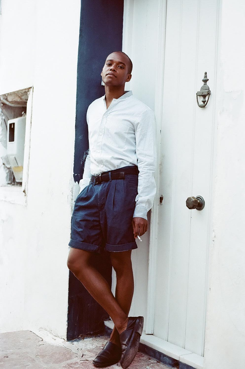 People fashion man smoking shorts