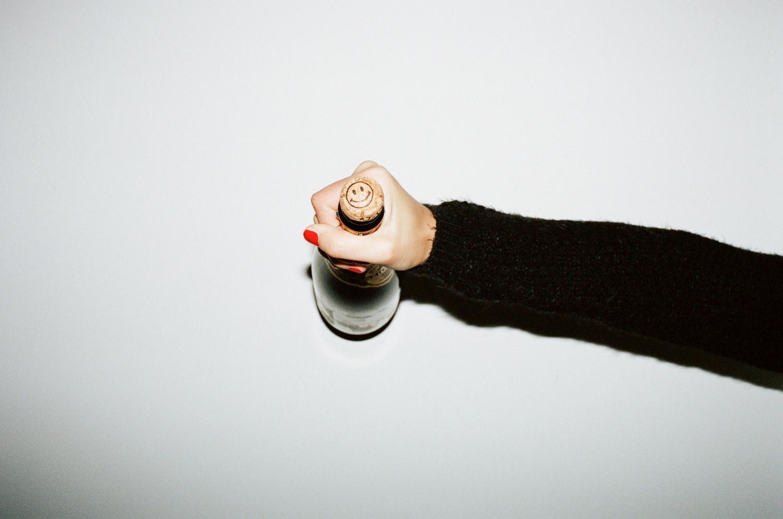 hand hands arm bottle bottles smily cork champagne