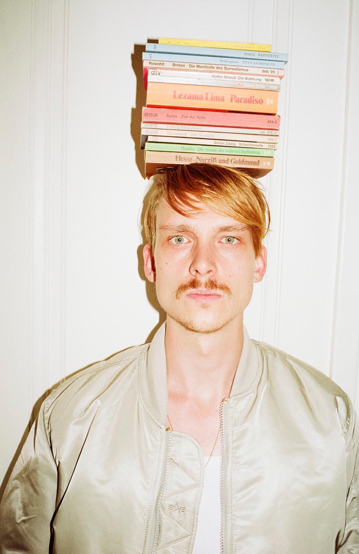 people man men indoor indoors blond book books head