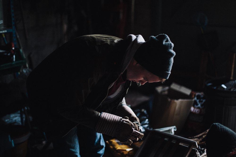 Lifestyle man indoor dark gloves