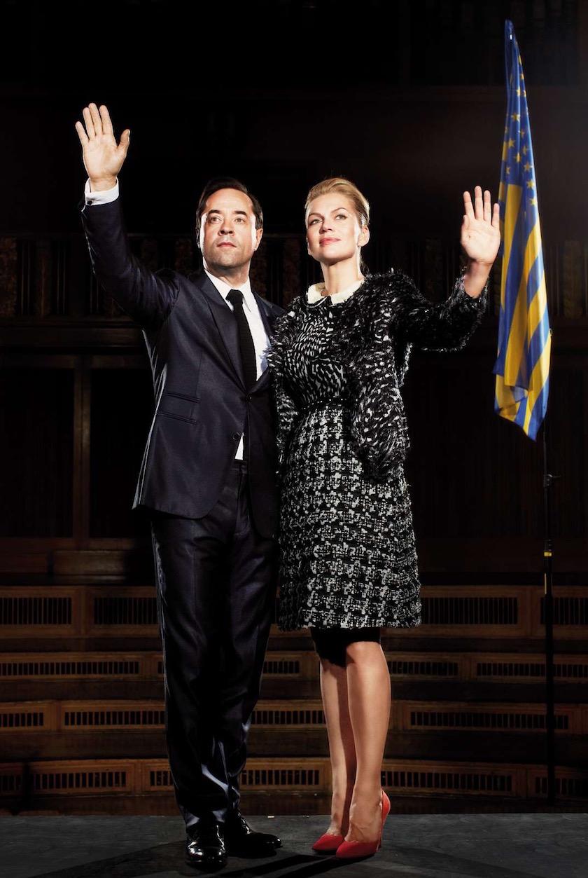 man woman president stage flag politics politician dress