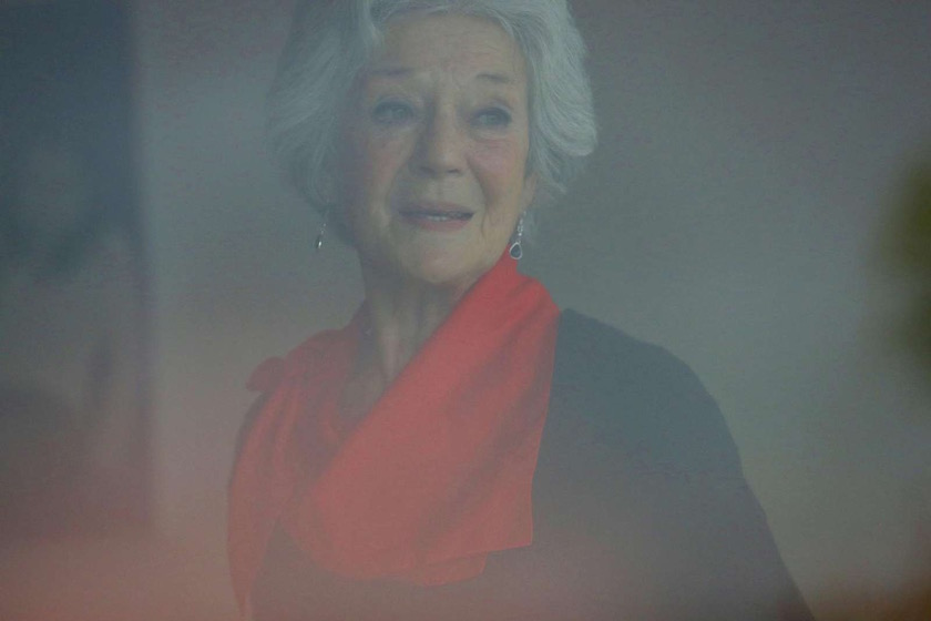 woman old senior mature scarf red blurry speaking face head expression