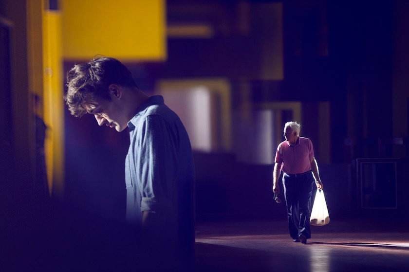 man outside mature senior grandfather father grandpa walk walking carry carrying bag plastic street city down tired sad