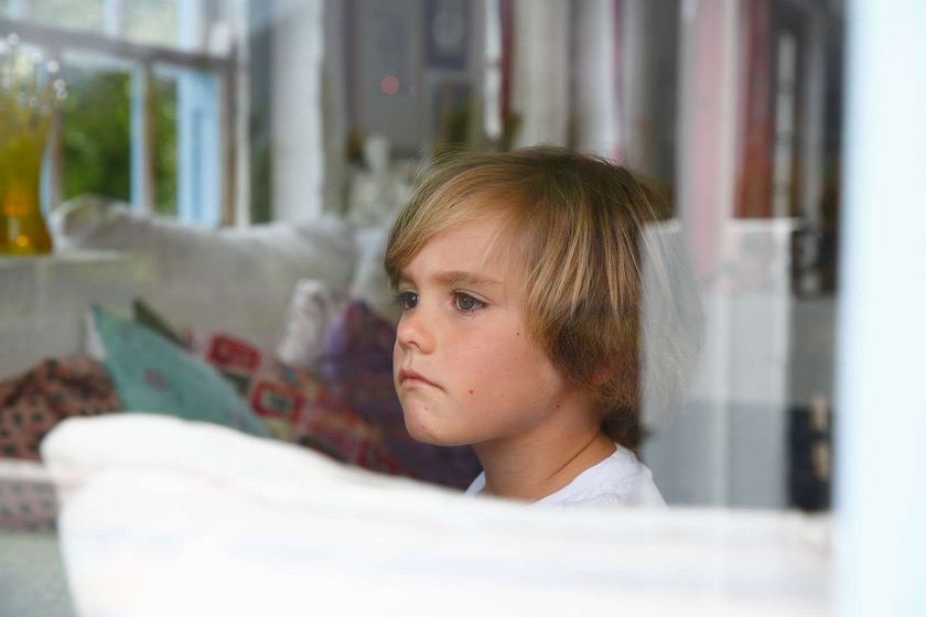 boy kid child children blond face expression window inside outside sad unhappy