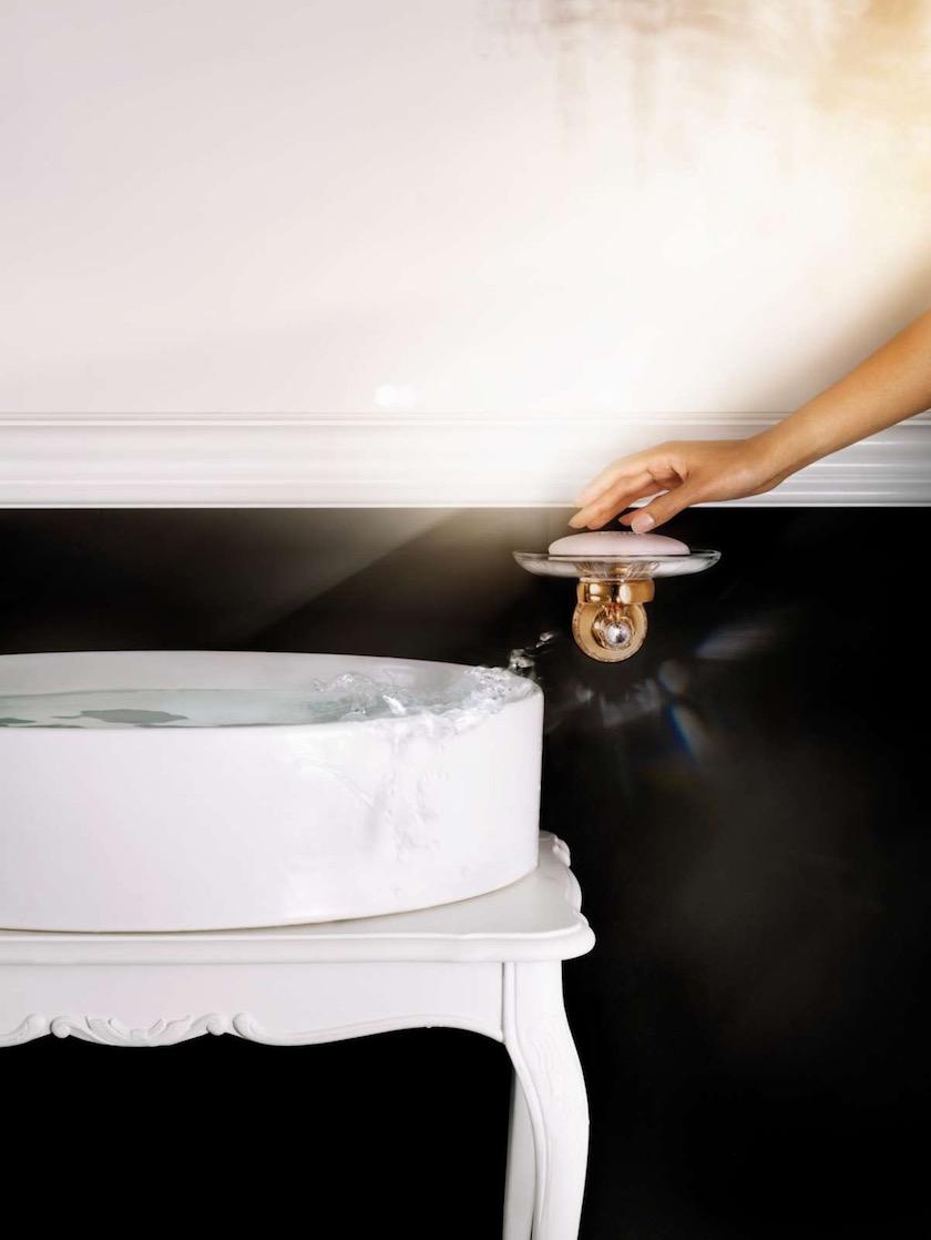 sink basin soap hand water wet stone black white