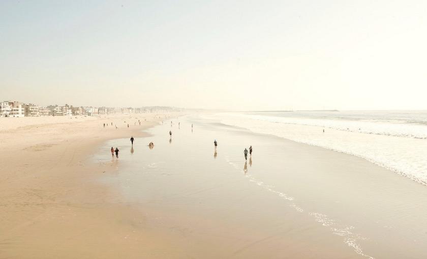 beach sand water sea ocean waves tides ebb flow people walking
